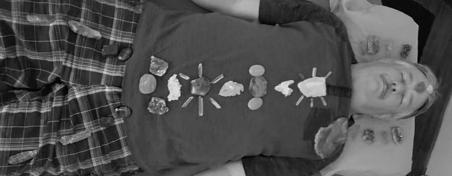 crystal layout on a man at Crystal Healing Concepts in Green Valley, Arizona